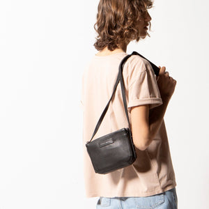 status anxiety black leather crossbody bag in her command studio hunterminx