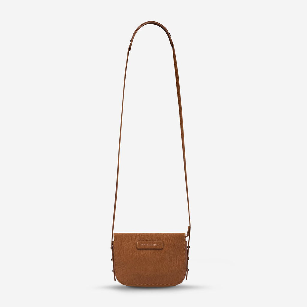 status anxiety tan leather crossbody bag in her command hunterminx