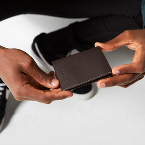 status anxiety wallet edwin chocolate lifestyle