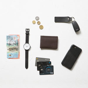 status anxiety wallet jonah chocolate lifestyle