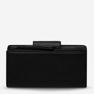 status anxiety wallet black ruins back
