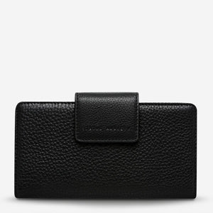 status anxiety wallet black ruins front