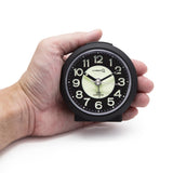 black portable small travel alarm clock