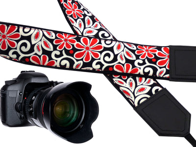 Padded camera strap with red and white flowers for DSLR SLR and mirrorless cameras.