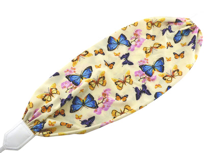 Colorful camera strap with flowers and butterflies.