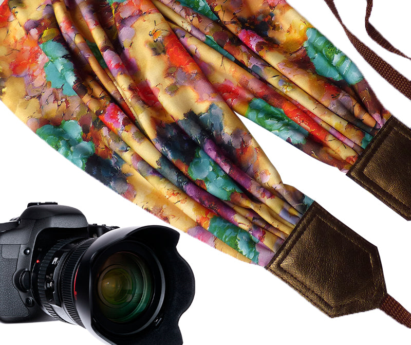 Scarf Camera Strap with colorful flowers design and golden ends.