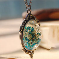Blue Flower Entrapped in Glass Pendant