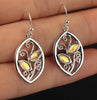 Golden Colored Studdend Stone Floral Earrings
