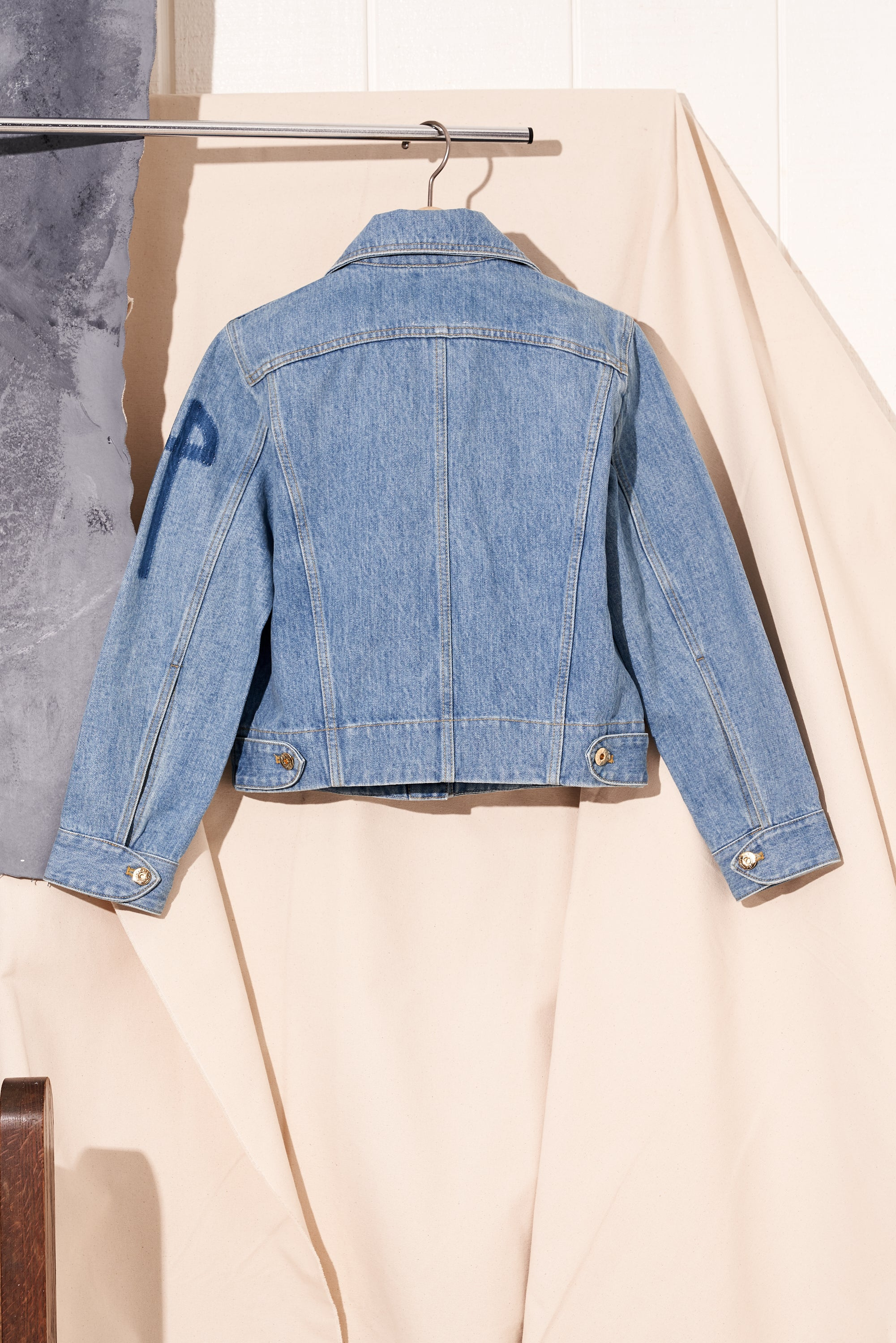 iconic denim jacket in light wash by patou, back view