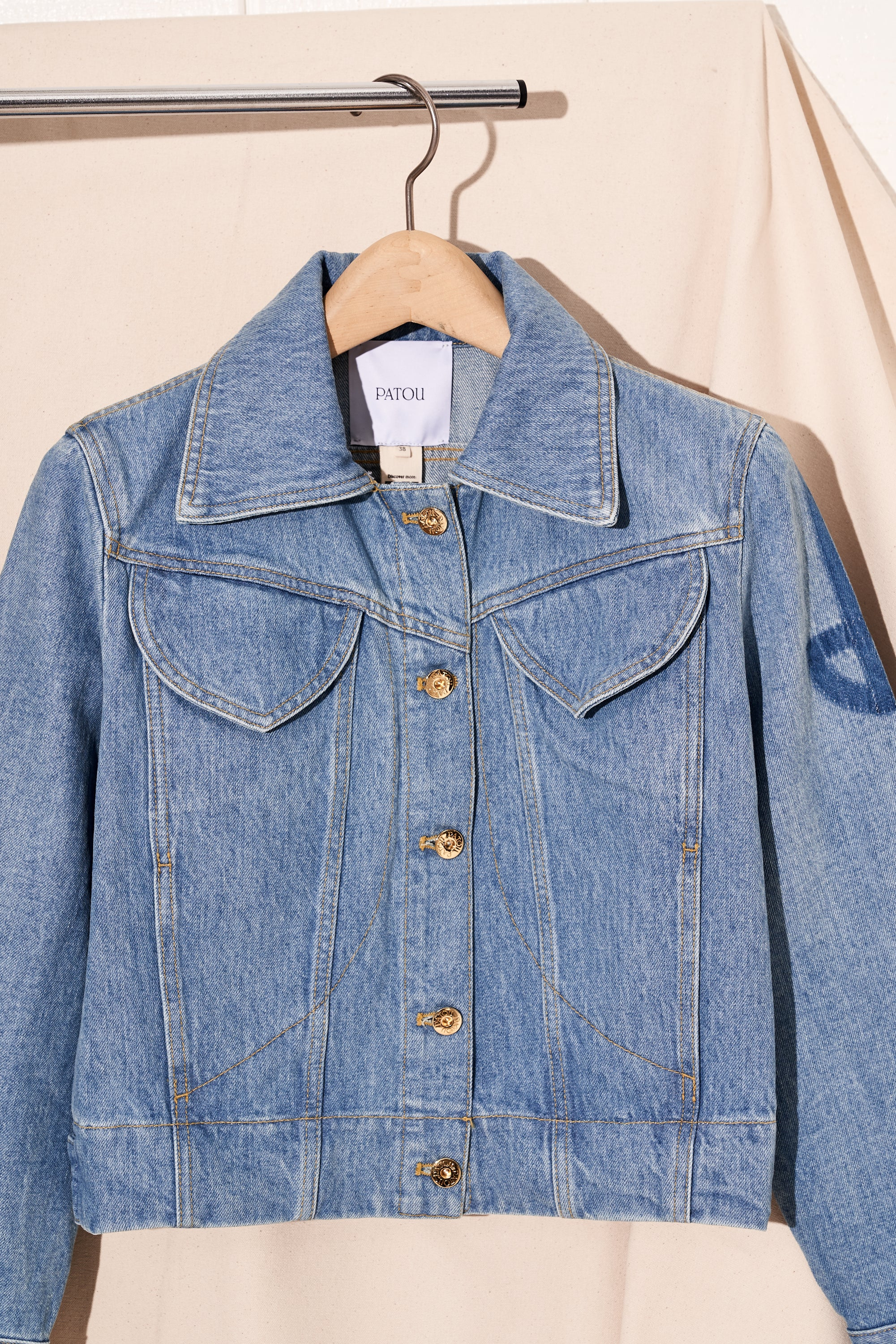 iconic denim jacket in light wash by patou, detail view front