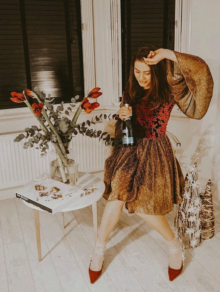 Tania Hergenhahn wears her AW18 Scarlet Mini Dress in Gold