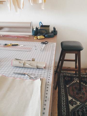 Cutting table and stool at SHAABI Denim