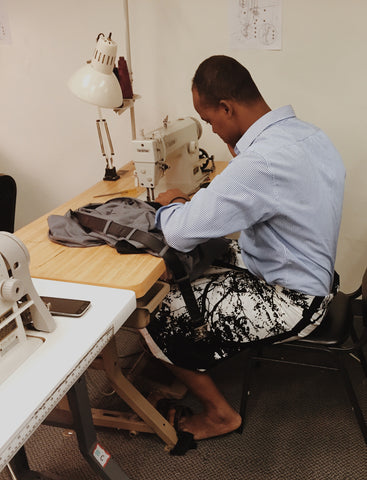 Man sewing at New Vestures