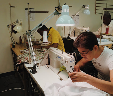 Men sewing at New Vestures