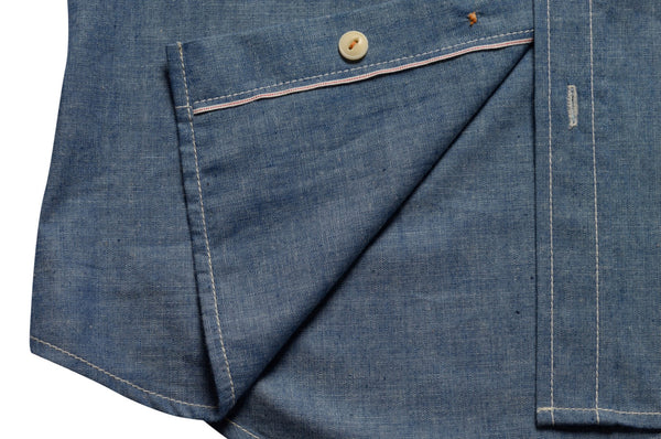 placket detail on chambray shirt by Shaabi denim
