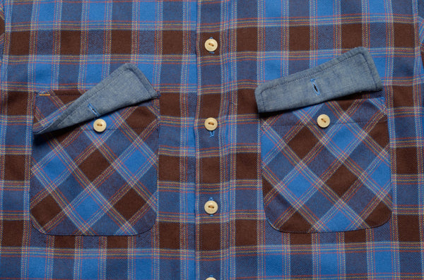 Pocket details on flannel button-down shirt by Shaabi