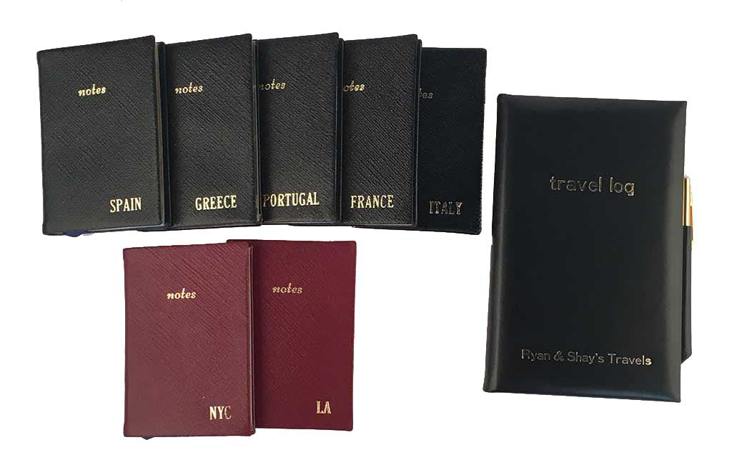 leather travel noes books labeled country and travel log