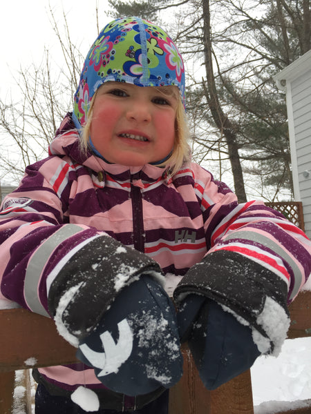 Toddler enjoying the snow in her Cubbies - mittens gloves that never fall off