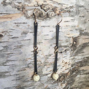 Nexus earrings with carved bone bead