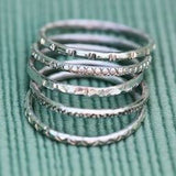 silver stacking rings with stamped designs and patterns