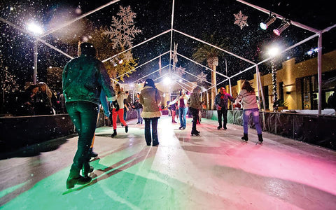ice skating under lights and snow