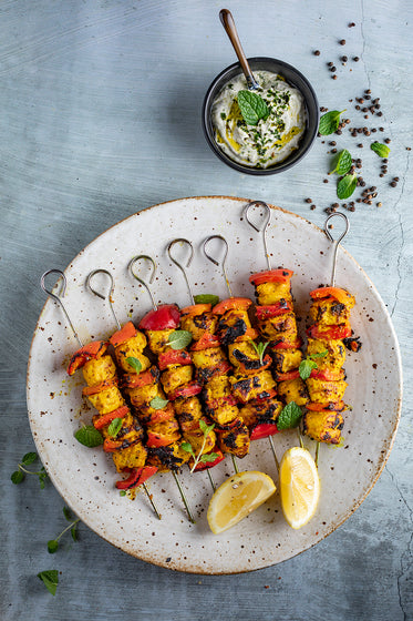 Turmeric, black pepper chicken kebabs with quinoa tabouli