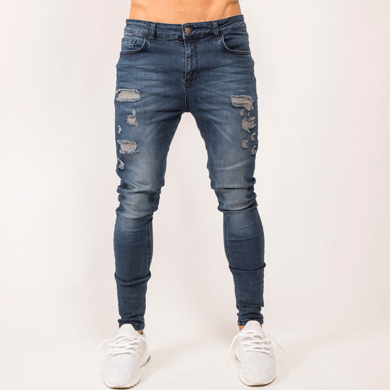 Ripped Denim Jeans - Mid Wash