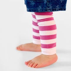 little girl using ballerina stripes model of pima cotton leg warmers