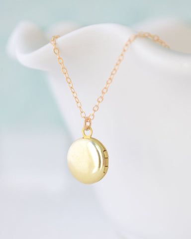 Tiny gold locket