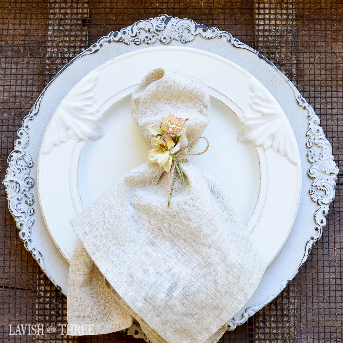 Charger plate in aged white shabby chic french cottage victorian romantic place setting