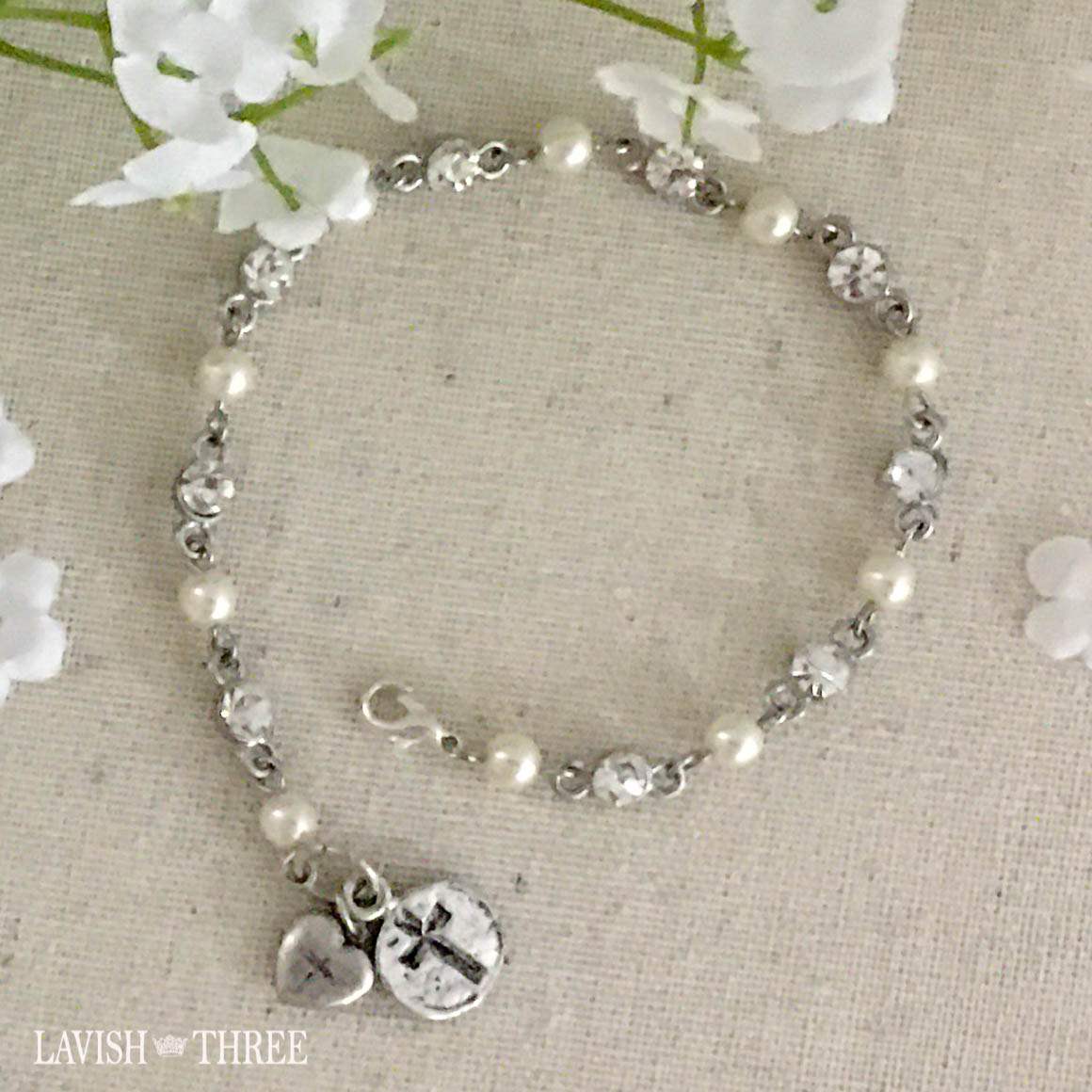 Silver and pearl bracelet with heart and cross charm Lavish three 3