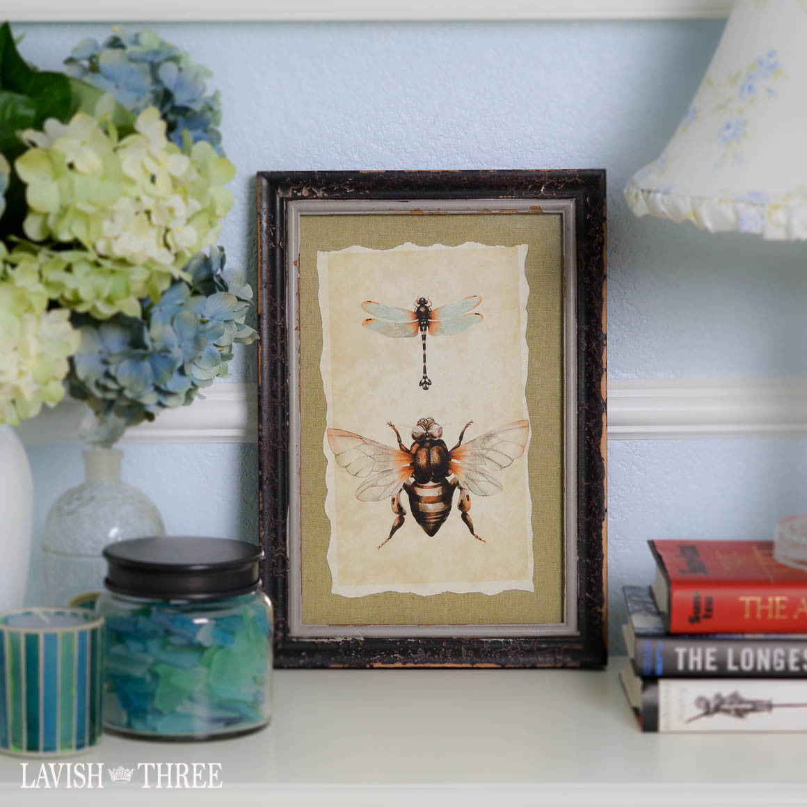 Distressed wood frame with bumblebee dragonfly vintage print