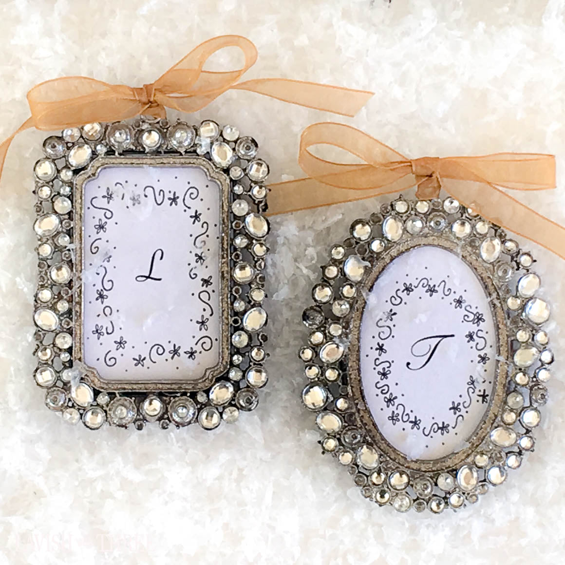 Jeweled pewter frames embellished with crystals hangs by gold ribbon ...