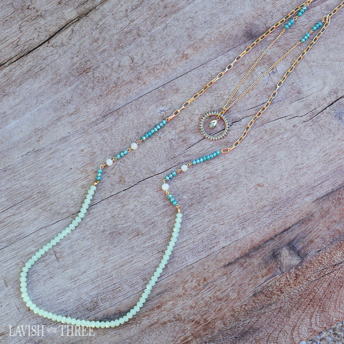 Gold chain necklace with blue and green beads and pendant