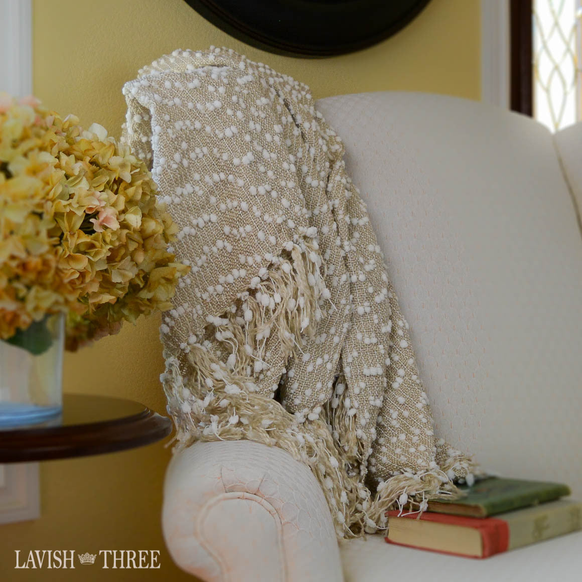 Tan and white decorator throw blanket with fringe