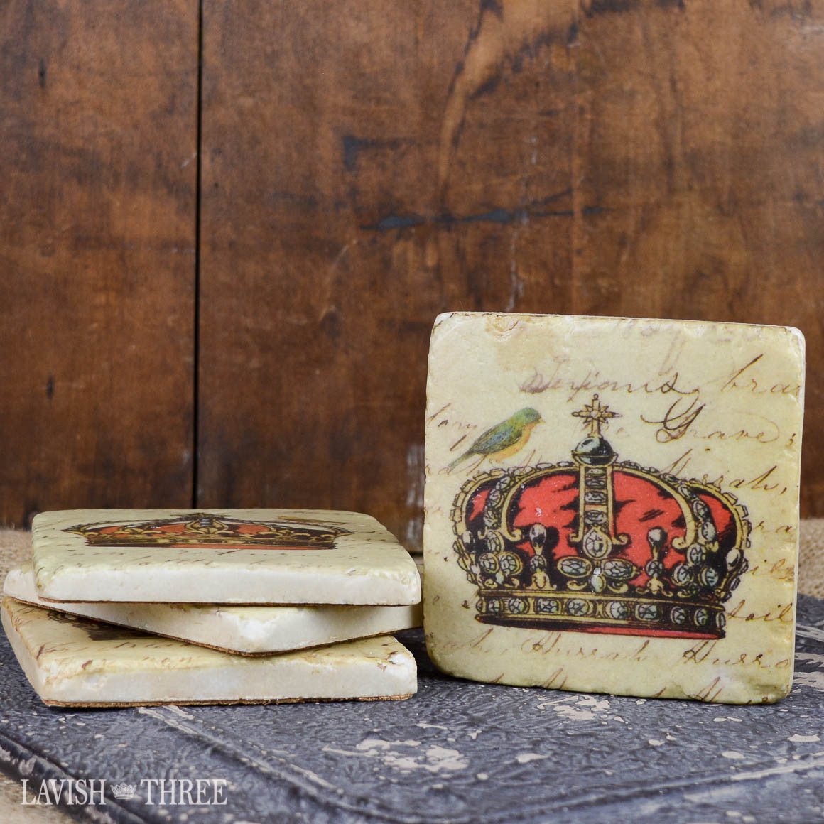 Coasters with crown design and bird