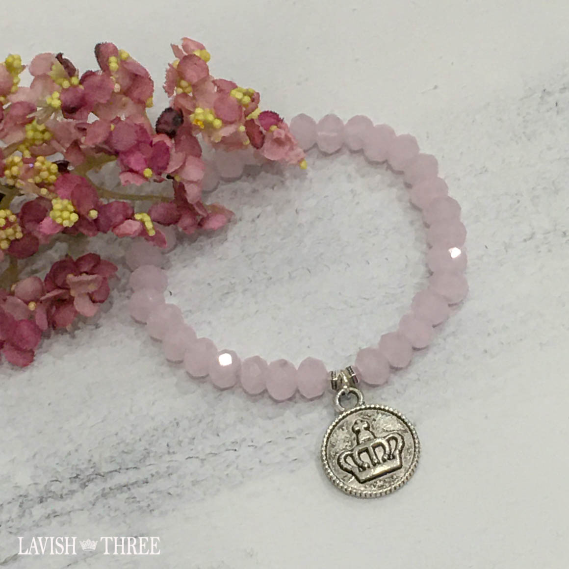 Pink bead bracelet with silver crown charm lavish three 3