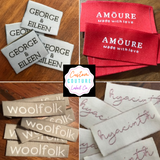 Woven labels with self adhesive backing