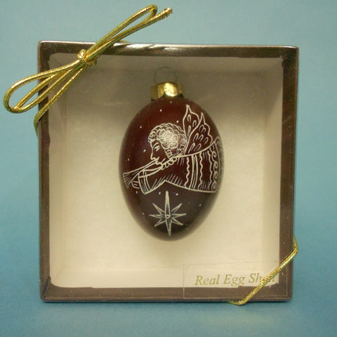 Maroon egg Ornament with Angel with Trumpet Design by Daniela Mahoney.