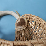 Colorado artist Barbara Mincer designed this wall pocket basket around an antler shed naturally by a white tailed deer (detail).
