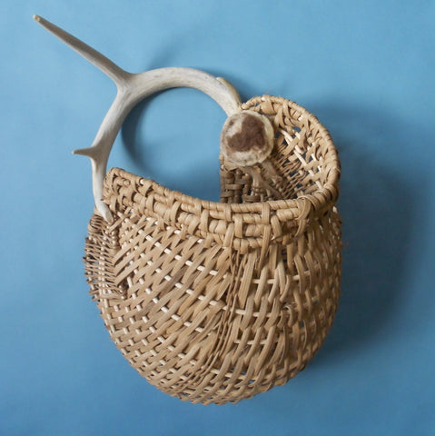 Colorado artist Barbara Mincer designed this wall pocket basket around an antler shed naturally by a white tailed deer.