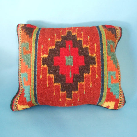 "Oregon weaver Francisco Bautista created this pillow featuring the ""Eye of God"" design and Zapotec rug weaving techniques."