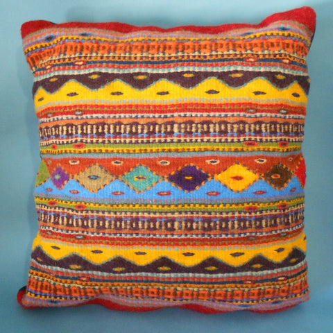 "Oregon weaver Francisco Bautista created this pillow featuring Zapotec ""lines of life"" design he learned in Mexico."