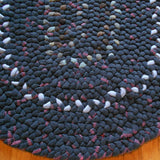 Detail of dark gray hand braided rug was made in Oregon using Pendleton woolen fabrics