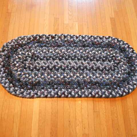 "Peggy ""the Rug Lady"" from Oregon created hand braided wool rug runner in blues and grays with violet accents."