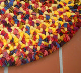 "Peggy ""the Rug Lady"" from Oregon created this hand braided wool rug by using strips of yellow and red Pendleton wool blanket-weight fabric."