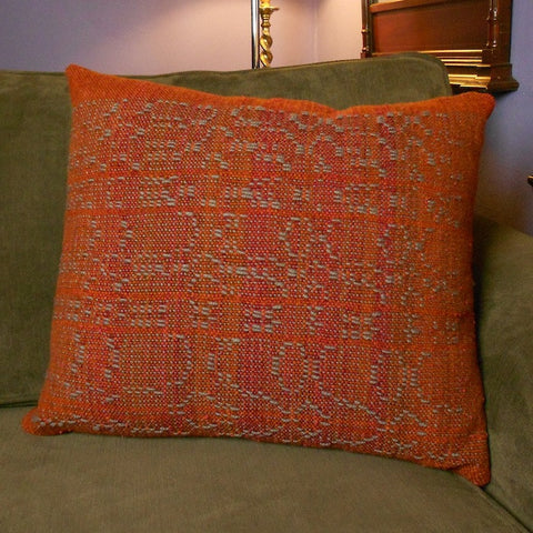 Handwoven throw pillow in burgundy and gray wool woven by Georgia Wier