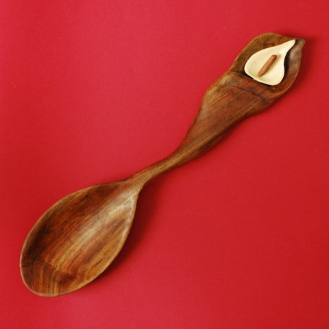 This decorative wooden spoon was hand carved in a Calla Lily design by Oregon woodworker Phil Lengelbach.