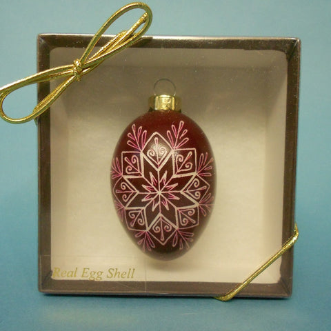 This 8-Pointed Star Chicken Egg Ornament in Magenta was created by Daniela Mahoney of Oregon.