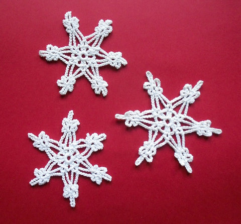 This set of three white crocheted snowflakes is by Mary Maynard of Wyoming